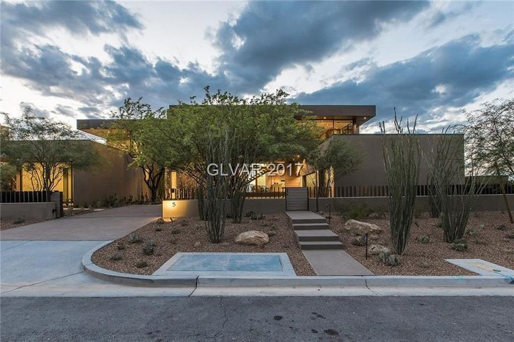 Marmol Radziner Architect inspired home with spectacular views of the Strip and Mountains. A desert contemporary home with an open plan living, dining and kitchen. Offering floor to ceiling windows, cider wood ceilings, custom cabinets throughout, multi-function rooms, spa, pool and built in BBQ.