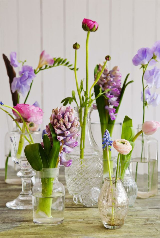flowers in bottles and jars