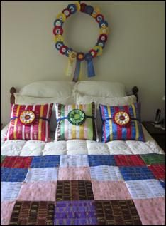cool ideas for horse show ribbons - make a quilt with the ribbons and a wreath with the rosettes
