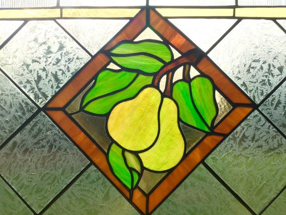 Pears Jubilee This woodsy all original stained glass transom is a very neutral panel that can lend its charm to any room in the house. Add a essence of nature and a connection to the outdoors to your kitchen, bathroom, den or bedroom. Look for more in this series.  Made in pale Amber, dark Amber, pear yellow-green, green, brown, clear combed, and clear glue-chip.  Measures approximately: 14x 30  All work is done by the artist themselves, we are an art studio, not a factory. Please see our…
