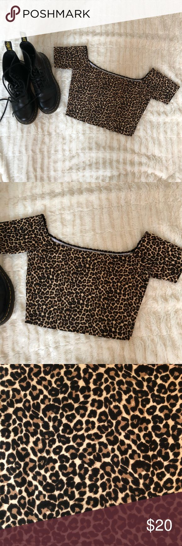 """NEW American Apparel Cheetah Print Crop Top M Animal prints are trending and this cheetah off-shoulder crop top is a perfect addition to your fall wardrobe. Layer with a cardigan for an effortless everyday look. Made from cotton and elastane.  Measures 12"""" length and 26"""" bust. Form fitting with plenty of stretch. Size M.  New Without Tags. American Apparel Tops Crop Tops"""
