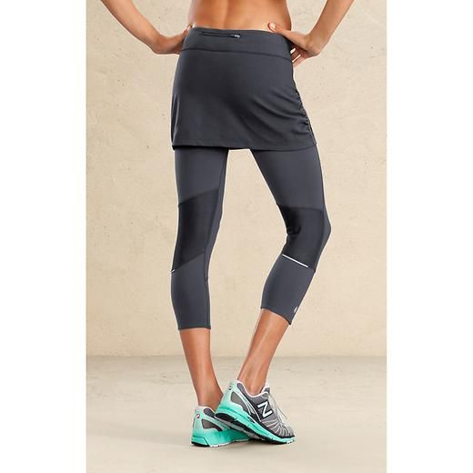 Contender 2 In 1 Skirt Capri - The all-in-one lightweight, wicking and ruched-skirt capri with reflective details to make sure youre visible on the run.