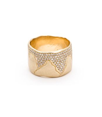 This ultra-wide band defines subtle luxury. A softly textured gold band is cracked and set with 0.76 cts of diamonds. Simply stunning! | (310) 310-3998