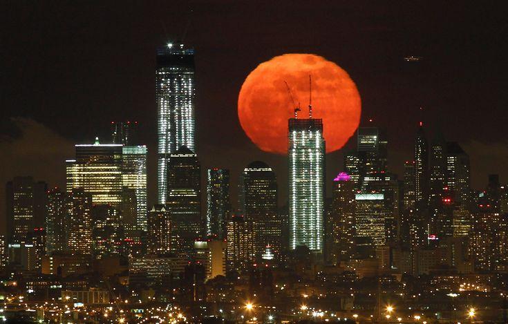 2012, May 6:  The moon rises over the skyline of Manhattan and One World Trade Center (left) in New York (Gary Hershorn/Reuters).  Annual perigree / supermoon - when the moon is at its closest point to Earth.  The effect is magnified during a full moon.  Photography, world events