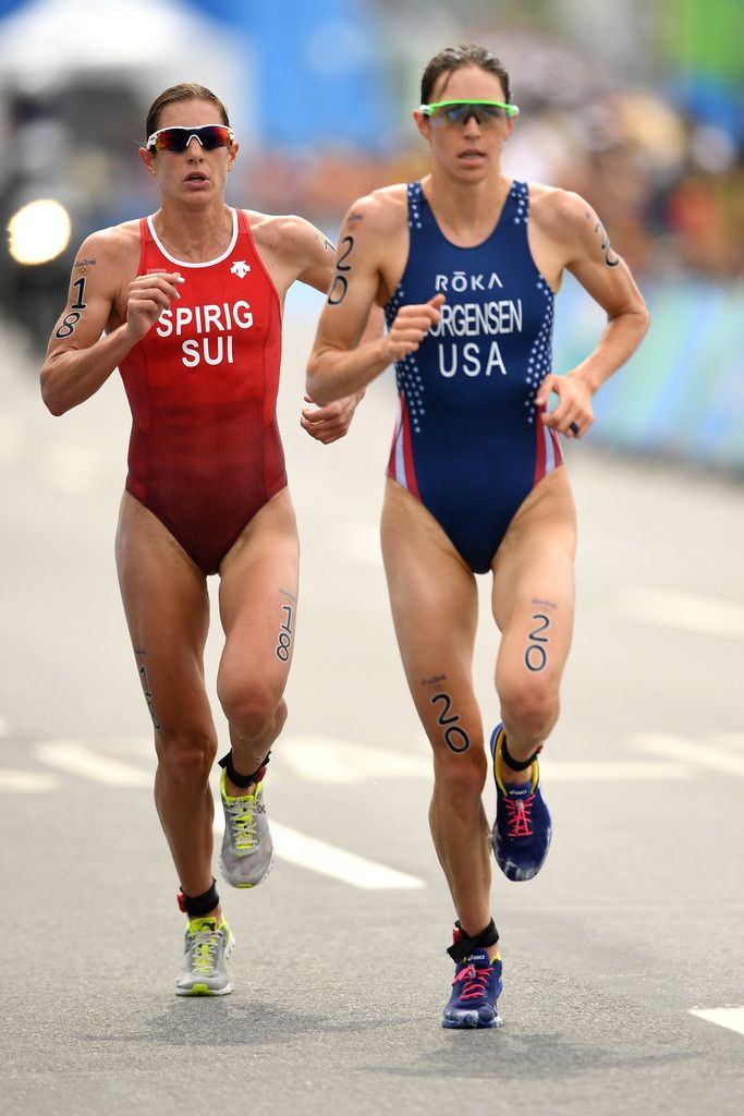 Nicola Spirig Hug (18) of Switzerland and Gwen Jorgensen (20) of the United States run during the Women's Triathlon on Day 15 of the Rio 2016 Olympic Games at Fort Copacabana on August 20, 2016 in Rio de Janeiro, Brazil.