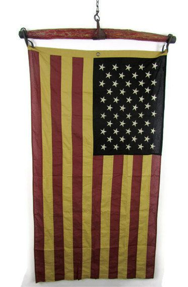 Old American flag on salvaged red  horse yoke.