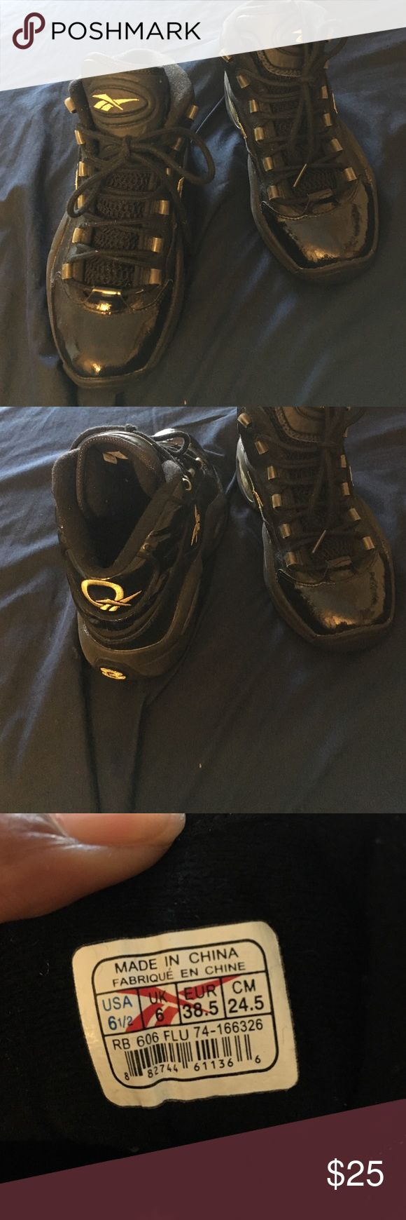 Black and gold Allen Iverson Boy sneakers Black and gold boy size 61/2 Allen Iverson's great for back to school. In awesome condition. Reebok Allen Iverson Shoes Sneakers