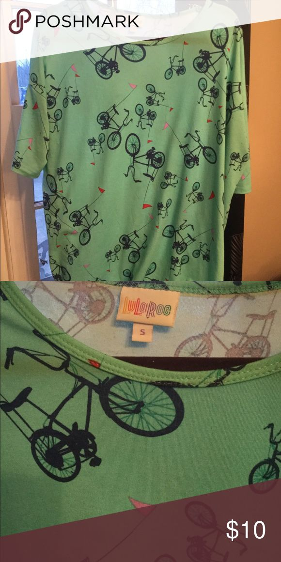 Lularoe Irma size small. Bicycles! Price firm. Teal Irma size small with Bicycles. Very good condition but does have just a bit of piling on the front. I didn't notice till I photographed it. I've priced accordingly! I would still totally wear this, but I'm going through all my Lula and selling all but my very favorites for cheap! Most are Like New! LuLaRoe Tops Tunics