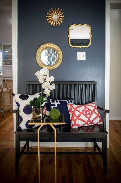 I like the navy blue wall with gold accents