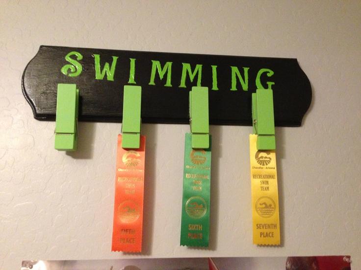 Fun way to display swimming ribbons.