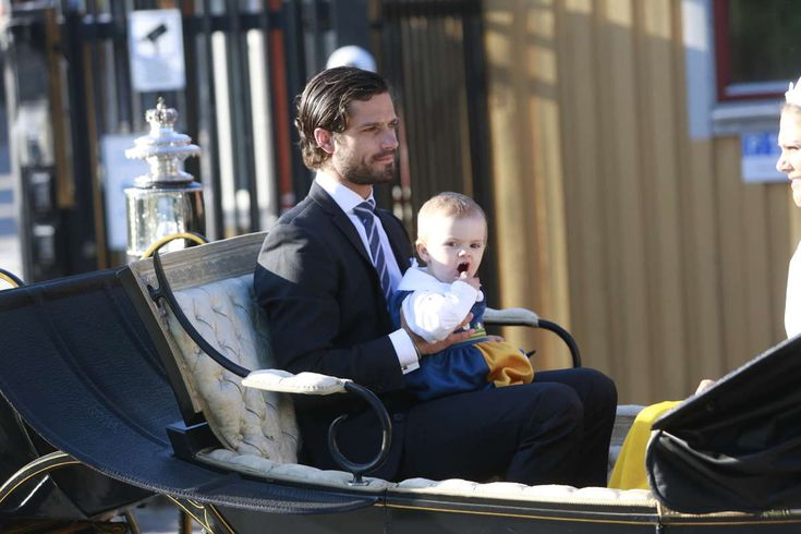 Prince Carl Philip with little princess Estelle of Sweden at Swedish National day celebrations 6/6/13