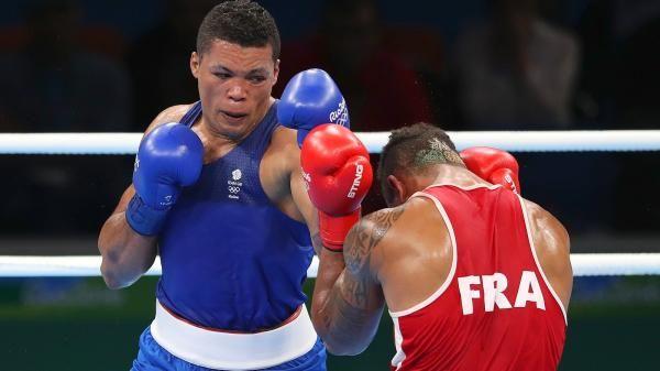 Joe Joyce, left, had to settle for silver in the men's super-heavyweight boxing final