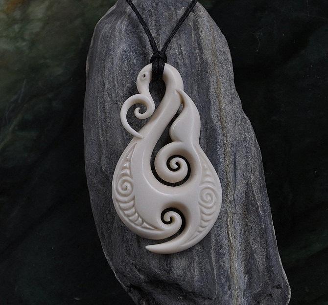 Manaia Fish Hook. Handcarved & engraved. $129.00, via Etsy.