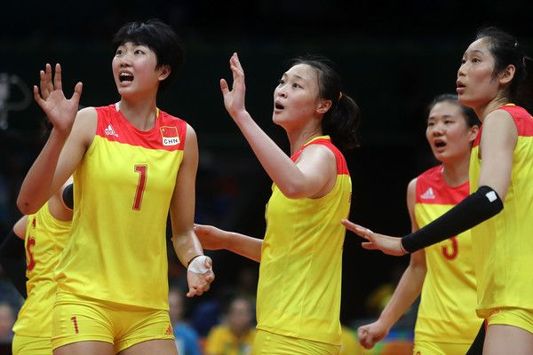 Ruoqi Hui Photos Photos - Xinyue Yuan #1 and Ruoqi Hui #12 of China dispute a call during the Women's Gold Medal Match between Serbia and China on Day 15 of the Rio 2016 Olympic Games at the Maracanazinho on August 20, 2016 in Rio de Janeiro, Brazil. - Volleyball - Olympics: Day 15