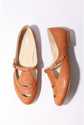 oh i want these. i love the orangey camel shade. and the cut-outs. and the little buckle.