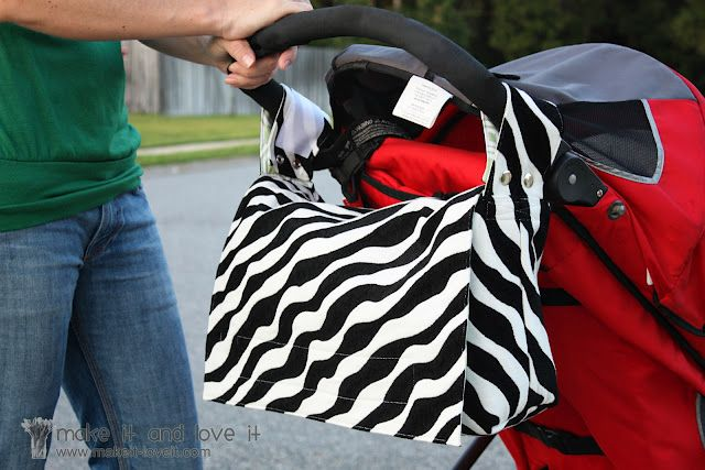 maybe @Brenda Jensen Grandma will make this stroller bag for my kids???  What an ingenious idea!  High enough not to kick it when you walk, but the strap magically gets longer (come in Grandma) when you have to go in or need it to sling over your shoulder! Tutorial and all here!