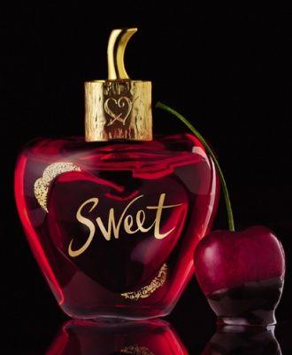 "New Lolita Lempicka perfume ""Sweet"". Top notes: cherry lip gloss, sugar; Heart: angelica, cocoa, iris; Base: musk, cashmere"