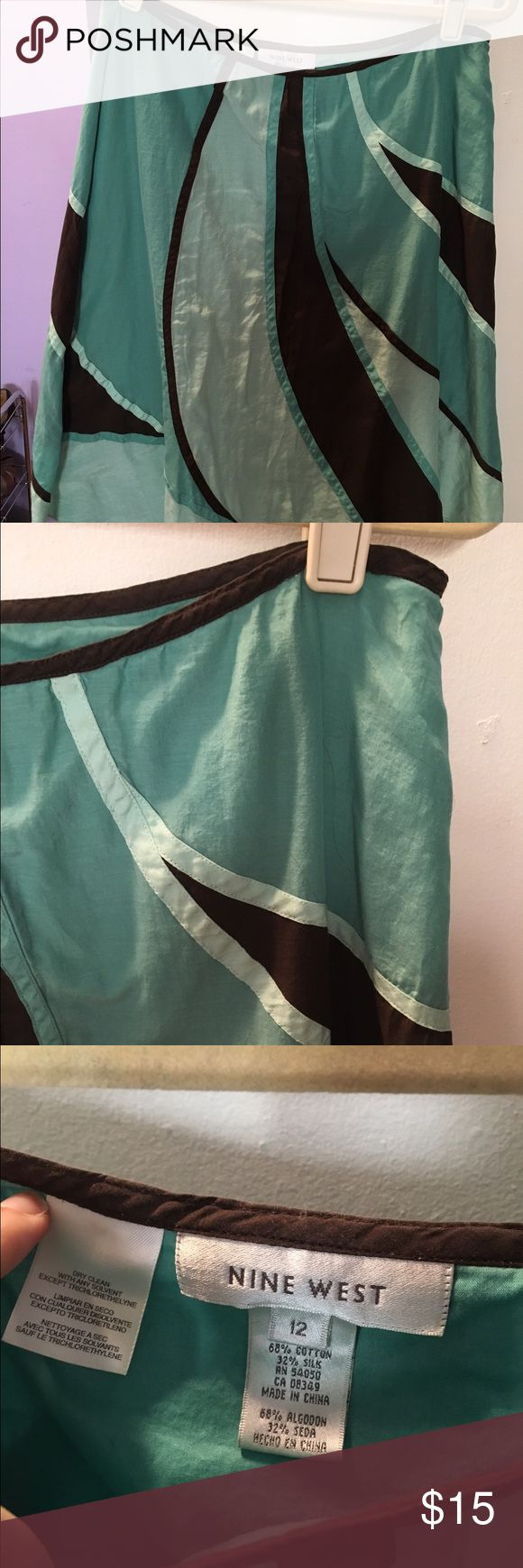 Nine West Teal and Brown Swirl Design Skirt This is a lovely linen, cotton blend skirt from Nine West. Different shades of Teal and brown. Great for showers or parties or work. I have a coordinating top, if desired. Nine West Skirts A-Line or Full