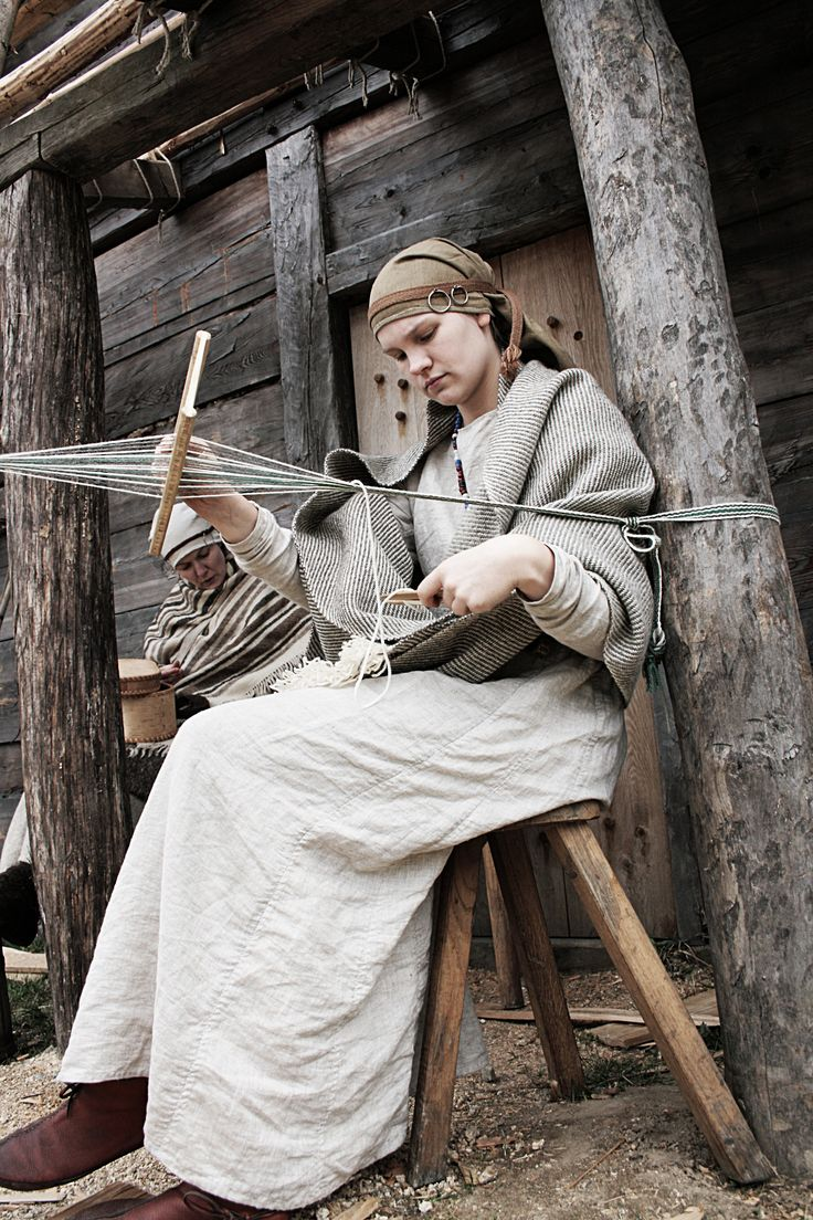 Rhoda reenacting a Western Slavic Woman from about 800-900. Everything is hand-sewn. The shoulder scarf is hand-woven. The temple rings are made out of bronze by Ludwig.  Photo taken by Ludwig. Rigig heddle weaving, from Lirhluthvik. http://lirhluthvik.deviantart.com/