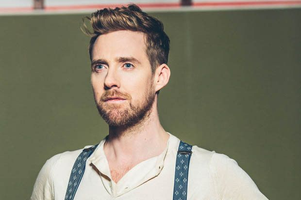 Thin Ricky Wilson with beards and braces.