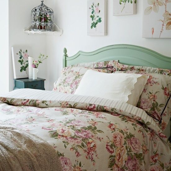 Floral country bedroom. It's clean, simple design is charming. I love how the bedding and wall prints tie together perfectly.  The painted headboard is my favorite thing.