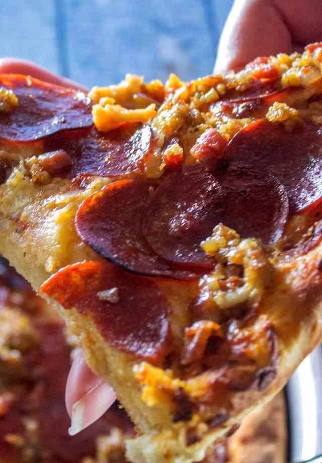 The original Godfather's pizza is the best pizza ever made. This copycat Italian Chicago style deep dish recipe is intended to recreate that amazing vintage taste. The crust is thick and the cheese is gooey. The toppings include pepperoni, sausage, prosciutto ham and bacon.