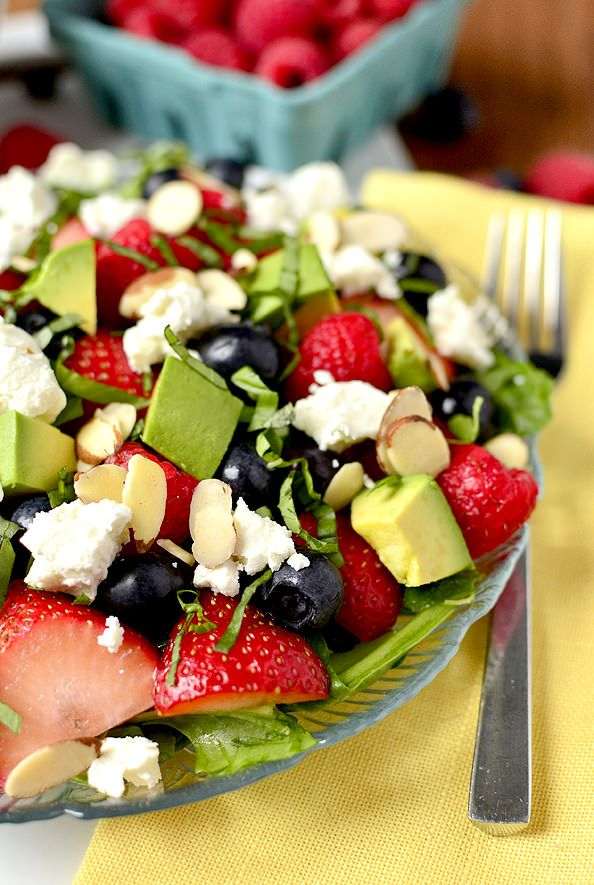 Triple-Berry Summer Salad | iowagirleats.com Ingredients: 9oz baby spinach, torn 1 cup sliced strawberries 1 cup raspberries 1 cup blueberries 1/2 cup sliced almonds, toasted 1/3 cup chopped basil 1 avocado, chopped 4oz goat cheese Divide baby spinach between plates then top with berries, almonds, basil and chopped avocado. Crumble goat cheese on top then dress with salad dressing. I recommend strawberry balsamic vinegar, but any olive-oil based vinaigrette would be fantastic.