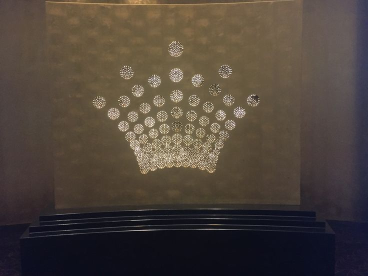 PHOTO TWO CROWN PLAZA LOBBY: A light installation found as you work into the crown lobby. The use of the crown logo to brand the building. The light adds glamour to the entrance which ties in with the luxurious environment crown creates