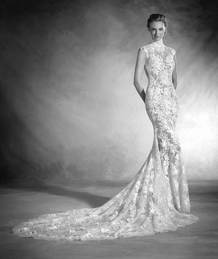 Un abito da sposa classico ed elegante, a maniche corte e collo alto. Scopri l'abito da sposa NIKOL confezionato in chantilly, tulle e ricami, perfetto per te.