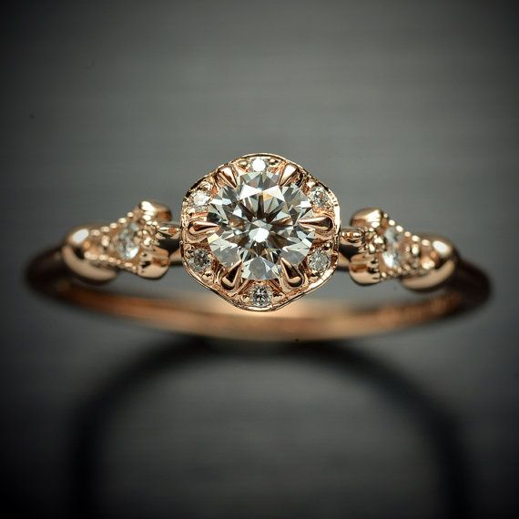 Diamond Engagement ring 14kt white, yellow, pink gold  with a round center GIA and flower halo