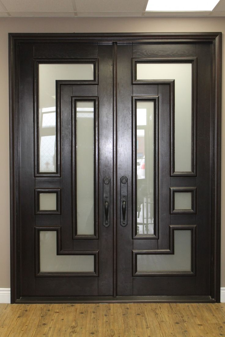 Artistic modern entry doors for home with twin black oak entry doors combined glass paneling and black handle doors featuring black sill ideas