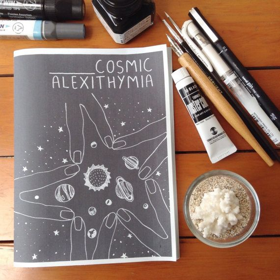 Cosmic Alexithymia (Elle Ominoreg) is a cosmic blend of 20 pages of writing, poetry, illustrations; all hand drawn with ink and watercolor.  Alexithymia which means a=lack, lexis=word, thymos=emotions--this zine is about the emotional blindness of inability to identify and describe my feelings, doubts, and fears towards my existence.