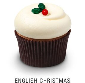 Georgetown Cupcake's version of the   traditional English Christmas spice cake,   baked with fresh cranberries and orange zest   and topped with classic vanilla cream cheese frosting and a fondant holly leaf