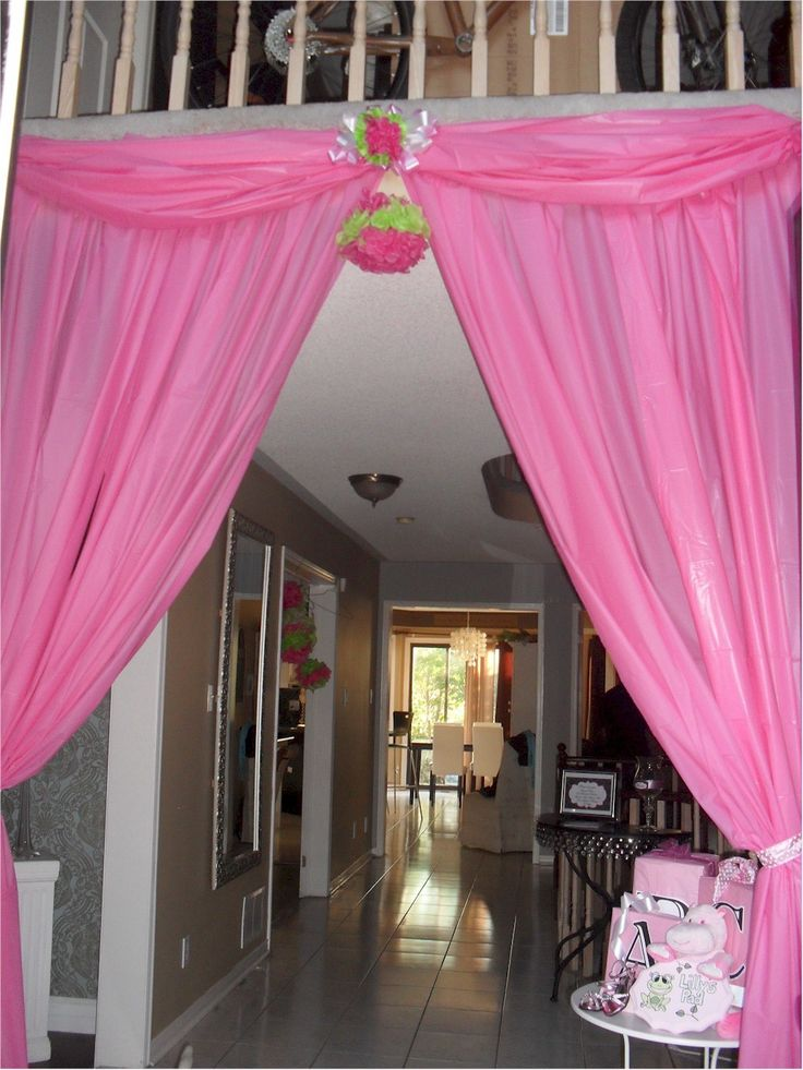 BABY SHOWER ENTRANCE  No streamers or balloons here.  This is the entry way into a Baby Girls shower. VERY COST AFFORDABLE. Plastic pink table cloths from the dollar store and tissue paper poofs.  Total cost = $10.00