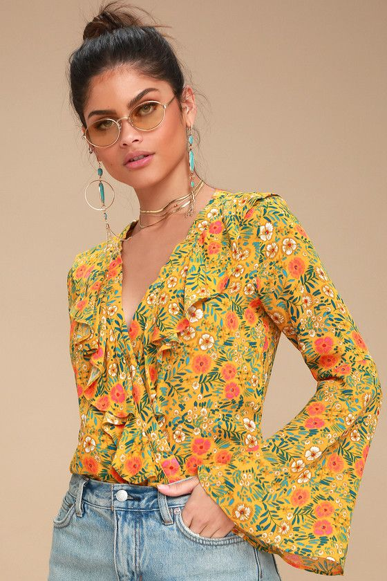 e0b8dcfba493f Make a groovy statement in the Can t Stop Loving You Mustard Yellow Floral  Print Bodysuit! A ruffled
