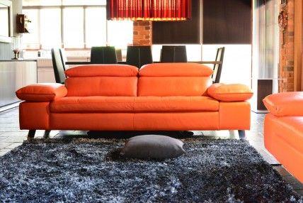 Harlem Leather Lounge: adjustable head and armrests, superior comfort in a modern lowline raised modern sofa.