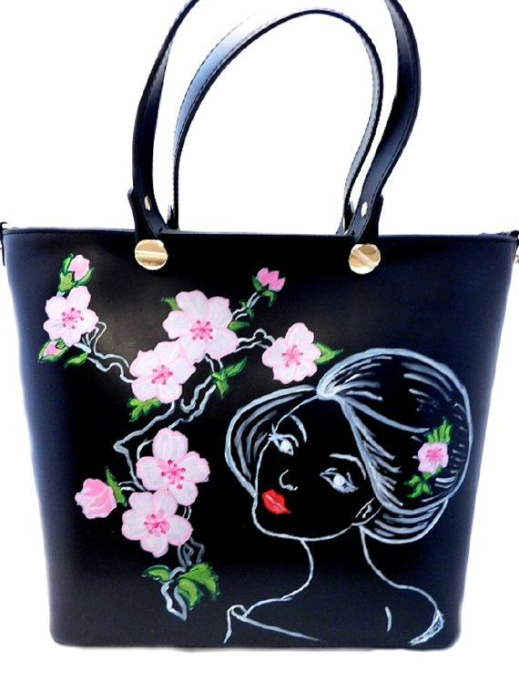 This painted bag offers the unbounded beauty of Sakura, meaning the Cherry Blossom. Sakura is the idea of renewing the spirit of the people. The contemplation of cherry blossoms, beautiful and fragile, has meaning to revalue its ephemeral character of life in perspective.  You can wear this fairytale landscape, along with the Geisha - an artist woman at any occasion, because it is very elegant. You will have a refined look.  Live each day to the maximum intensity and add a touch of…