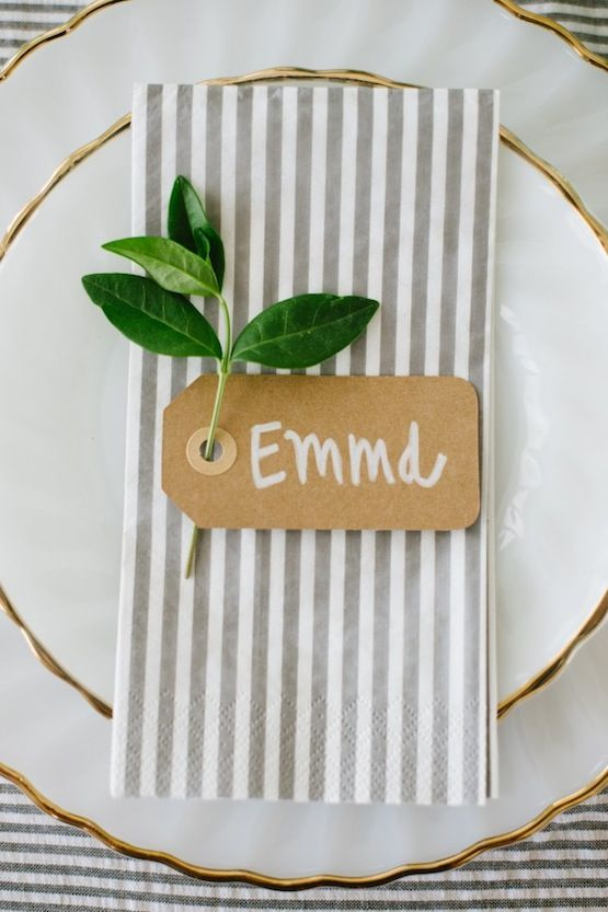 Try this with a wedding favor in a box or sleeve that also doubles as a name card instead of just a tag. :-) Cute idea for table settings--could do a leaf instead of the green sprig. Tag could say the name of the event instead of a certain person's name.