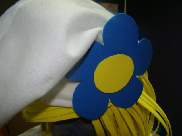 Smurfette hair made out of foamy craft paper (cut in strips), and the hat out of felt cloth.