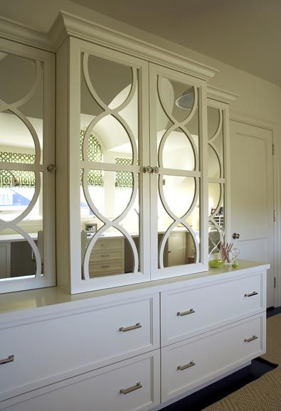 This custom-made cabinet, outfitted with mirrors and pull-out file cabinets, would rehabilitate a pack rat in no time.