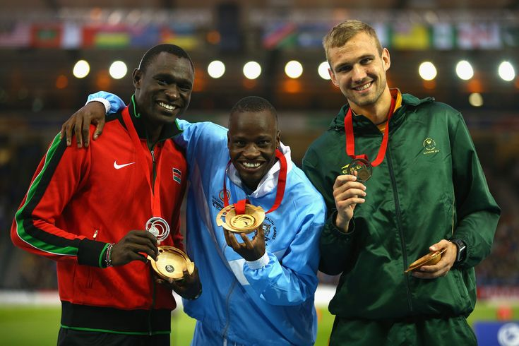(L-R) Silver medallist David Rudisha of Kenya, gold medallist Nijel Amos of Botswana and bronze medallist Andre Olivier of South Africa