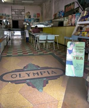 Olympia Cafe Stanmore One of the last of Australia's Greek-Australian-run milk bars; the Olympia's dilapidated shopfront speaks of a bygone era.