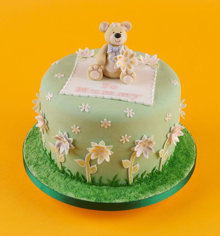 This cute teddy tops a cake decorated with our Daisy Stencil & Cutter Set.