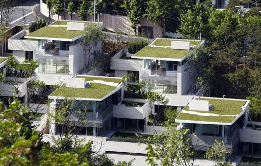 Joel Sanders Architect and Haeahn Architecture, Seoul, So. Korea. Located in the exclusive district of Seongbuk-dong where precious traditional architecture and natural landscape is preserved. A steeply sloping site, this enclave of 12 private houses is designed so every residence possesses private outdoor space and unobstructed views. The project weaves together building and landscape, natural and synthetic materials, and indoor and outdoor spaces.