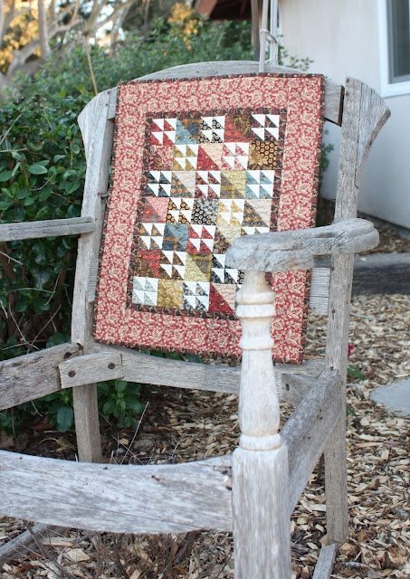 Great display - I love the chair as much as the quilt....