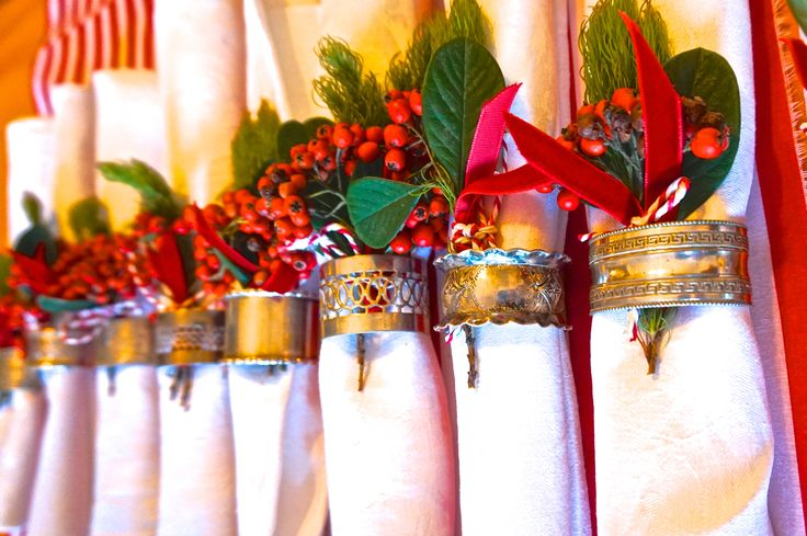 napkins with red berries and silver napkin rings #whitespacesdesign http://www.whitespacesdesign.com