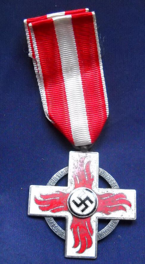 This is the Fire Brigade Decoration (2nd Class) awarded for service in fire fighting actions.