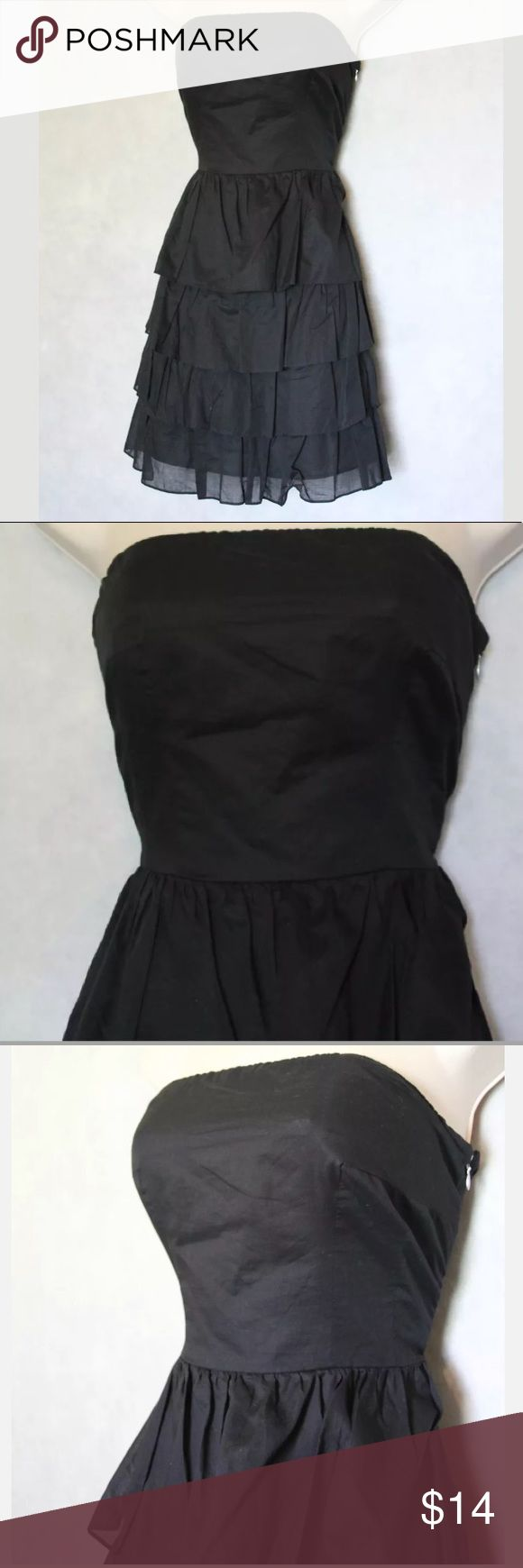 MAKE AN OFFER‼️Express Party Dress Size 12 Express Dress Women's Size 12 Solid Black Ruffle Tiers Strapless Side Zipper Great Condition! No Stains or Tears! Cute Dress!   Measurements: Bust: 16 1/2 in Length: 28 in Express Dresses Strapless