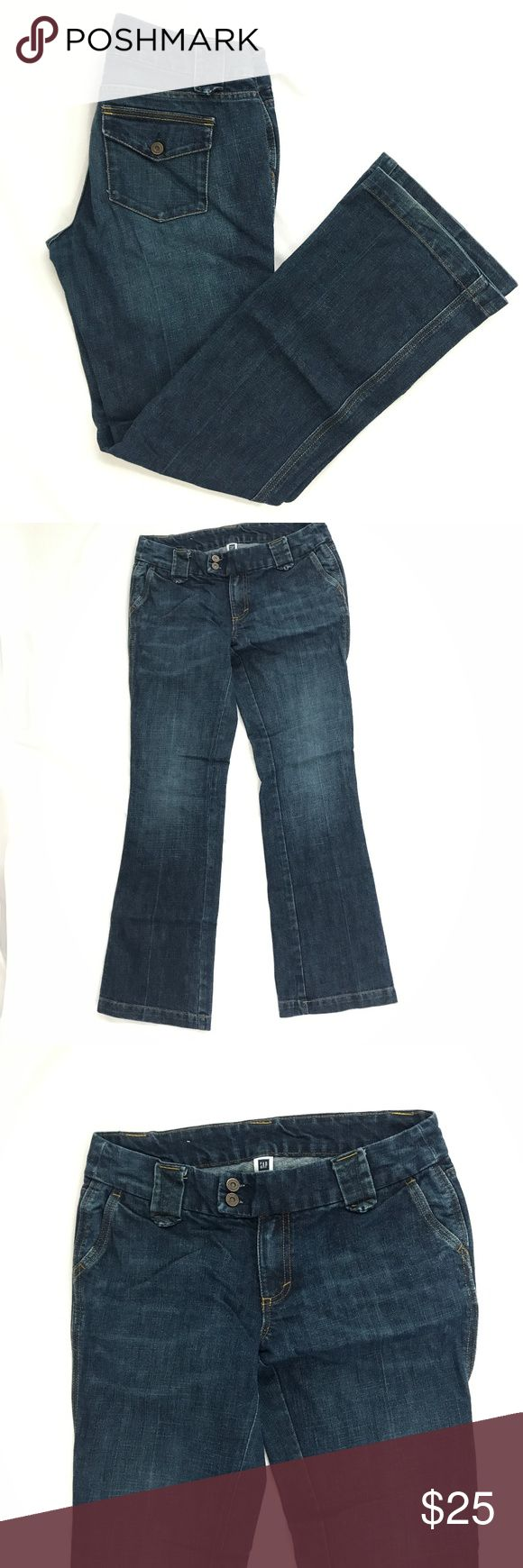 Gap Trouser Jeans Sandblasted Flare/Bootcut Gap Outlet Trouser Jeans Flare/Bootcut Leg with sandblasted wash Gently Used with slight wear/fading on bottom of leg openings near hemline. No Frays Size: 4    Measures:  Waist: 16 inches across laying flat    Rise: 8 inches   Inseam: 31 inches  Leg Opening: 18 inches around  85% Cotton, 15% Polyester GAP Jeans Flare & Wide Leg