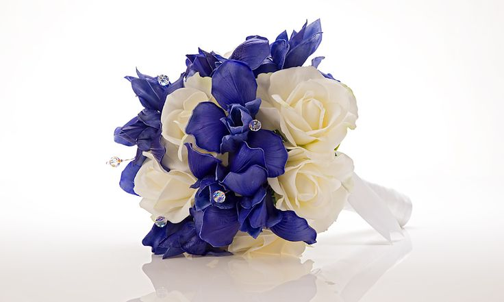 Bold blue iris bridal bouquet with white roses